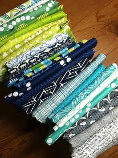 Fabric Stack   Flickr - Photo Sharing!  Maybe bright modern prints with bright colors from yellow greens to aqua or turquoise and add some dark navy and grey too?