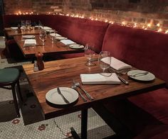 Reclaimed American chestnut was milled by Longleaf Lumber for these tables, now in a New York City restaurant.