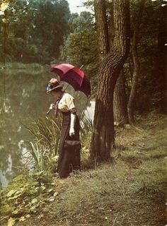 Woman by pond, ca. 1906....color-tinted