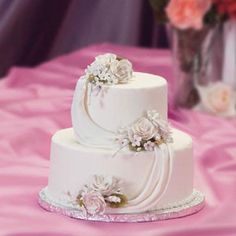 I love the two teared cake, just enough elegence without being too extravagent (or expensive!)