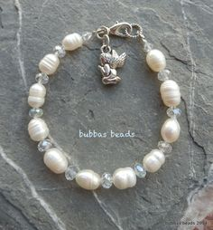 Pearl and crystal bracelet with angel charm. www.facebook.com/bubbasbeads