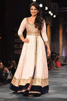 Parineeti Chopra showcases Manish Malhotra's creation during Shabana Azmi's charity fundraising fashion show 'Mijwan' at Grand Hyatt in Mumbai on September 3, 2012.