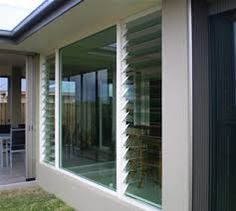 A mix of louvered and solid glass windows Louvre Doors, Louvre Windows, Home Design Decor, House Design, Glass Balcony, Living Room Windows, Exterior Remodel, Window Styles, House Extensions