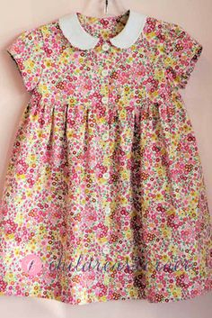 Children's Corner Ruthie #282. Button-up front dress with short of long sleeve, this dress is sure to make her want to twirl! Perfect back-to-school option