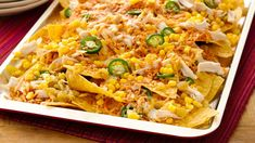 Easy Chicken Ten Minute Nachos - These nachos are the perfect way to use leftovers! We've provided a suggestion, but simply use what you have on hand; then top with some fresh additions after baking. The perfect quick dinner that everyone will love! Mexican Dishes, Mexican Food Recipes, Dinner Recipes, Ethnic Recipes, Mexican Meals, Mexican Chicken, Dinner Ideas, Cheesy Chicken, Nacho Recipes
