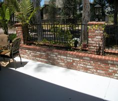 Brick and wrought iron fence. Brick and wrought iron fence. Brick Fence, Front Yard Fence, Brick Wall, Backyard Fences, Front Yard Landscaping, Landscape Bricks, Wrought Iron Stairs, Backyard Fireplace, Modern Fence