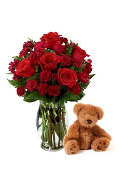 Deep red roses and a teddy bear are the perfect gifts for someone you love ♥