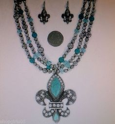 NEW! FLEUR DE LIS SILVER AND TURQUOISE NECKLACE AND EARRING SET . REALLY PRETTY!!