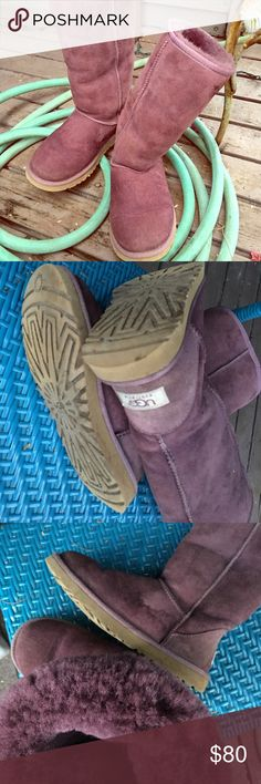 "UGGS classic shearling boot in purple w/ugg tag 5815 the Classic Tall's an icon of casual style.  flexible EVA outsole. Foam and UGGpure™ wool insole Patent-protected tread design 11 ¾"" shaft height Imported  The suede side of Twinface sheepskin is susceptible to staining and discoloration when exposed to moisture. This product contains real fur from Sheep.   Preloved: A bit of light staining, not detracting or distracting. They don't look new for sure, but they still look great for 1/2…"