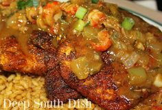 Blackened Catfish with Crawfish Etouffee - Catfish fillets, dredged in blackening seasonings and cooked in a hot cast iron skillet, served over Cajun Rice Pilaf and finished with an etouffee sauce with crawfish.