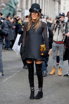 What is with the Gummi Bear Purse?   And she is WAAYYY to old to be dressing like this! Street Style: Paris Fashion Week. Too much for my taste!