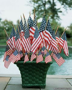Find creative ways to display the American Flag just in time for the Fourth of July and Memorial Day. From cake toppers to bicycle decorations, find festive options, here. 4th Of July Party, Fourth Of July, 4th Of July Wreath, Memorial Day, Displaying The American Flag, Summer Centerpieces, Centerpiece Ideas, Table Centerpieces, Doodle