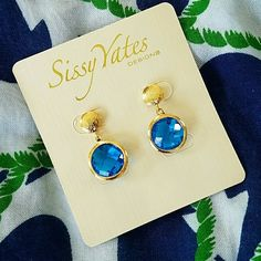 """Earrings w/Blue Stone 12mm crystal centerpieces on brushed gold plate. Earrings hang 1"""" long and are for pierced ears. Sissy Yates Designs Jewelry Earrings"""