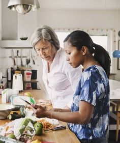 Mother and daughter-in-law cooking | Is there any other kind? (Sorry, sorry, we'll be nice.) But honestly, how often has your mother-in-law paid you a compliment that somehow feels like criticism? Or your sister-in-law makes a comment that sounds innocent but feels judgmental? Here's how to handle those jabs—and these often tricky relationships—with grace.