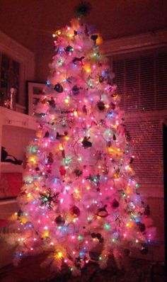 our white christmas tree with colored lights and colorful ornaments so bright and cheery - Christmas Tree White Lights