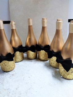 Gold Glitter Wine Bottle Decor with Bow Ties, Wedding Table Decor, Set of Party Table Centerpieces, Black and Gold Centerpieces - DIY Mittelstücke Wine Bottle Centerpieces, Party Table Centerpieces, Homemade Centerpieces, Wine Bottle Decorations, Graduation Centerpiece, Wine Decor, Centerpiece Ideas, Glitter Wine Bottles, Wine Bottle Crafts