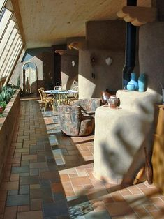 Earthship interior - length of the home.  Open, functional spaces.  Warm and inviting.  love the tile flooring