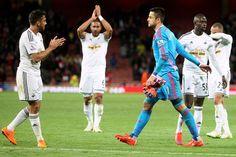 Man-of-the-match Lukasz Fabianski leads the celebrations at Arsenal