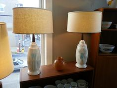Just added these #Midcenturymodern #1970′s Ceramic base lamps in white with teak stem.. SOLD