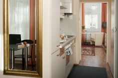This apartment combines style with much coziness. Double bed or 2 single beds possible. Double Beds, Oversized Mirror, Furniture, Home Decor, Bedroom, Living Room, Little Kitchen, Full Beds, Decoration Home
