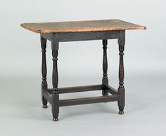 """Pook & Pook.  October 2nd 2010.   Lot 498.  Estimated: $800 - $1200.   Realized Price: $2370.   New England pine tavern table, late 18th c., retaining an old black surface, 26 3/4"""" h., 33"""" w., 21"""" d."""