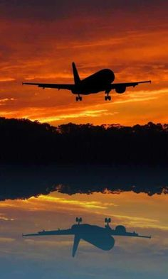 SILOUETTE OF A DC TAKING OFF AT SUNSET...LOVE TAKE OFF!