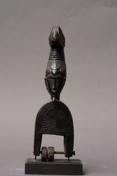 Africa   Heddle pulley from the Baule people of the Ivory Coast   Wood   Image ©Michel Renaudeau