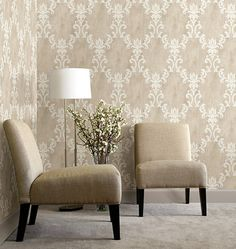 A scrolling damask wall covering of gleaming neutrals, dresses walls in a grand design of ornamented style.