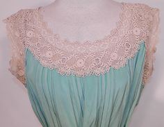 Vintage Aqua Pleated Silk Irish Crochet Lace Belted Chemise Shift Slip Dress. This lovely lace loose fitting chemise style straight shift slip dress has a matching silk fabric tie sash belt, with lace trim yoke neckline and is sleeveless.