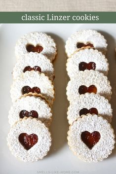 german christmas cookies Weihnachtspltzchen Linzer cookies with raspberry filling: The ultimate Christmas cookie! Delicate and delicious, they are major showstoppers for your holiday cookie platters and swaps! Christmas Desserts, Christmas Treats, Christmas Baking, Christmas Cookie Boxes, Christmas Holidays, Jelly Cookies, Filled Cookies, Baby Cookies, Heart Cookies