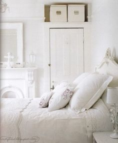 Love the white fireplace in the white bedroom