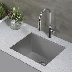 Opt for a sleek and modern stainless steel sink, like this Kraus Stainless Steel Laundry and Utility Sink. http://www.ybath.com/blog/modern-laundry-room/