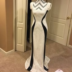 Custom Made Leather detailed long dress size s/m Gorgeous custom made dress. Never worn. Leather detail in front. Zipper closure, gorgeous train in back. Pictures do not do this dress justice! Id say will fit small-medium. Not jovani, just put for recognition. Jovani Dresses