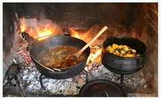 Potjiekos - originated with the Voortrekkers that evolved as a stew made of any available meat and vegetables made in a three-legged cast-iron pot over coals