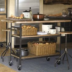 We love the industrial chic of the 54-inch-long SoMa Island, made of solid limed oak and recycled steel with locking caster wheels; $999 at Chefs Catalog.