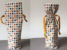 Wine bottle fabric bag with drawstring, free tutorial on Craftsy