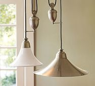Pair of large metal pendants for the kitchen. They have a weighted 'acorn' and a pulley! The idea is you can pull them up and down from the ceiling as needed- for cleaning or to get them out of the way. Very nice.