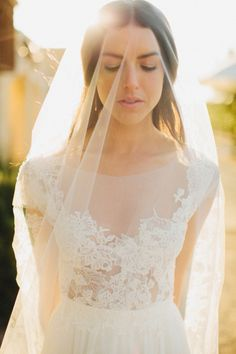 This #bride has such a beautiful #glow in this #sunset #weddingpicture #love the #weddingdress #lace detailing and #simple #veil #weddingphotography by @matthewmorgan See more here: http://matthewmorgan.net/blog/