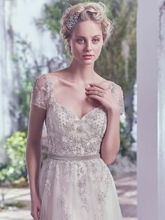 11 Wedding Dress Trends to Get You Excited for 2017 - Kylie by Maggie Sottero. White is classic, but off-white is delightfully unexpected. Shimmer in Alba's (Sottero and Midgley) champagne colorway, or opt for luxe dimension in Kylie (Maggie Sottero).