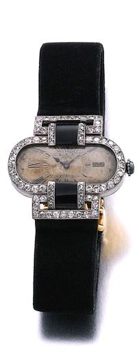 LADY'S ONYX AND DIAMOND WRISTWATCH, CARTIER, CIRCA 1910 The oval dial applied with blued steel hands and Roman numerals, the bezel and shoulders millegrain-set with polished onyx, single-cut and rose diamonds, inner circumference approximately 145mm, dial indistinctly signed Cartier, numbered, French assay marks.