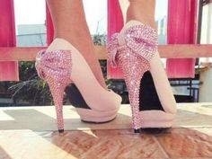 pink sparkly bow pumps.
