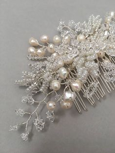 DETAILS | A beautiful bridal hair comb featuring branches of freshwater pearls, seed beads, and mixed Swarovski crystals. STYLING | The Evelyn headpiece would perfectly sit in hair that has been swept back into a low modern chignon or hair that has been partially secured into a