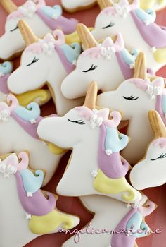 Pastel unicorn decorated sugar cookies with a shimmery gold horn. They look so Zen!