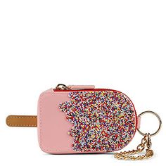 "GORRETO change purse in ""light pink"" (shown) $18 at Aldo--LOVE this little coin purse and the sprinkles just put it over the top!"