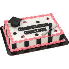 Use pre-cut fondant DecoShapes® dots and strips and gum paste accents for upscale grad cakes