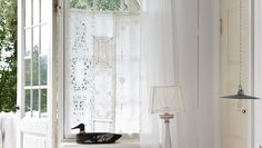 Look how each piece of lace runner was added to make this window curtain panel. Source Is from Sweden, I think.