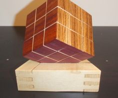 DIY Wooden Rubik's Cube made with magnets instead of gears.