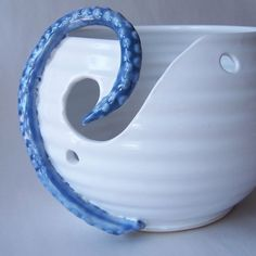 Cool! Yarn bowl with a blue octopus tentacle, from wildcardpottery.