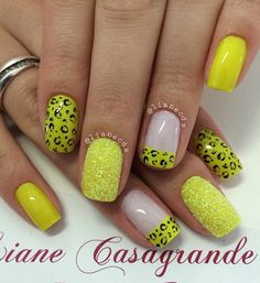 A charming yellow leopard nail art design. The leopard prints look absolutely perfect on the yellow base as well as the French tips and other designs on the nails.