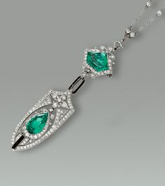 EMERALD, BLACK ONYX AND DIAMOND PENDENT NECKLACE, CIRCA 1915 The fine chain spectacle-set with circular-cut diamonds, to a detachable shield-shaped pendant pierced in a floral motif suspending a pear-shaped emerald and single- and circular-cut diamond swing, the surmount set with a pentagonal-shaped emerald, joined by a calibré-cut black onyx link.